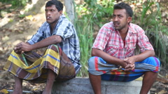 Two elephant keepers sitting near the Temple of the Tooth in Kandy. Stock Footage