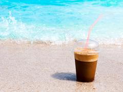 Coffee at the beach Stock Photos