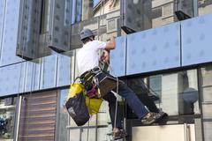 climber wash windows - stock photo