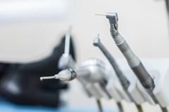Dentist selecting his items. dentist equipment. stomatologist tools Stock Photos