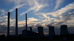 Silhouette of power station at dusk, real time Stock Footage