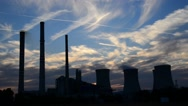 Stock Video Footage of silhouette of power station at dusk, real time