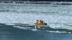 Small boat among the sea ice - two footage Stock Footage