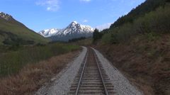 Flight over railroad with snowy mountain background - Alaska Stock Footage