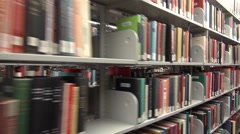 Library book shelves and racks, public libraries, books, college library Stock Footage