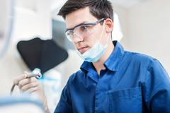 Skilled doctor.portrait of a successful dentist at work Stock Photos