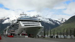 Cruise ship in port of Alaska - snowy mountains background - stock footage