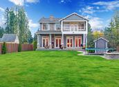 Stock Photo of luxury house exterior. backyard view