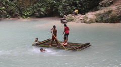 Children play on a raft in Tumalong Falls pool Stock Footage