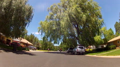 Rolling Street In Well Manicured Suburban Neighborhood Stock Footage