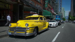 Retro taxi cab on street - old car, Vancouver Stock Footage