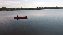 Man Paddling A Red Canoe On A lake In Canada Wilderness Stock Footage