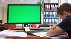 Man sleeping on the table near green screen of pc, chromakey - stock footage