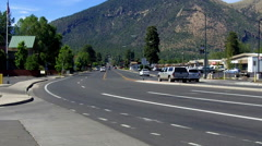 Traffic On Street In Central Flagstaff Arizona With Mountains Stock Footage