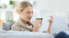 young woman buying on internet, using tablet - stock footage