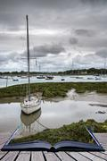 Landscape of moody evening sky over low tide marine creative concept Stock Photos