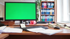 Engineer working place with green chromakey screen pc and hardhat - stock footage