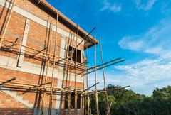 townhome & construction site in progress to new house - stock photo