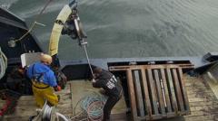 Alaskan crab fishing boat - windlass working, two footage - stock footage