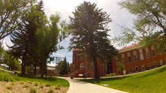 Bike Riding Past Old Main Building- Northern Arizona University Stock Footage