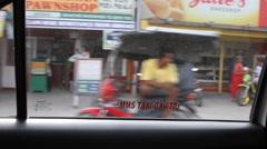 Cab drive through a Philippine village Stock Footage