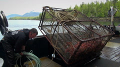 Alaskan crab fishing boat throw a trap - Alaska Stock Footage