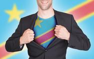 Businessman opening suit to reveal shirt with Democratic rep. of Congo  flag Stock Photos