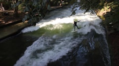 Urban Surfing in the english garden in Munich Stock Footage