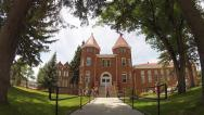 Stock Video Footage of People Walking By Old Main Bldg- Northern Arizona University