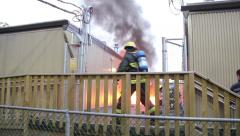Firemen running and shout asking for water - stock footage