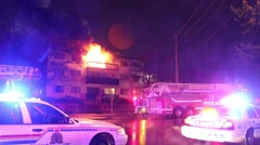 Firemen planning fire attack with flames showing Stock Footage