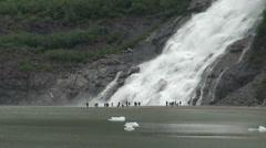 Big waterfall with peoples - Alaska, Mendenhall glacier Stock Footage