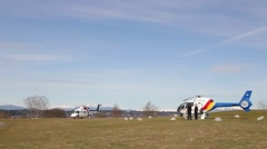 Police and ambulance choppers side by side Stock Footage