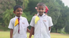 Sri Lankan children in school uniform playing in the Botanical Gardens. - stock footage
