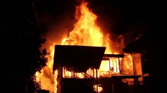 Fully involved house fire with two exposures Stock Footage