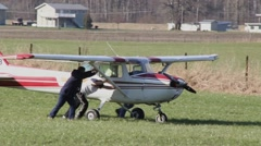 Crash investigator pushing plane with dmaged wing Stock Footage