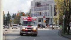 White and red ambulance arriving on scene Stock Footage