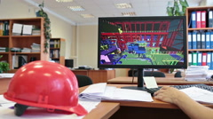 Red hardhat on the table and pc screen with 3d project Stock Footage