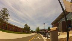 Riding In Bike Lane On Northern Arizona University Campus Stock Footage