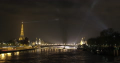 4K time lapse of the Eiffel Tower and river Seine in Paris at night Stock Footage