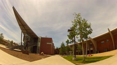 Rolling Between Buildings On Northern Arizona University Campus Stock Footage