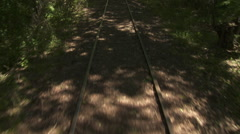 Moving along woodland railway tracks in summer - stock footage