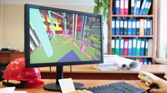 Monitor screen with 3d model of industrial plant, engineer work place - stock footage