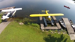 Aerial View Floatplanes Moored At A Northern Lodge Stock Footage