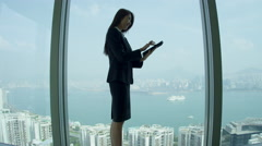 Asian Chinese Broker Successful News Mini Tablet - stock footage