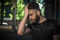 handsome young man with beard - stock photo