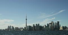 4K day to night time lapse of the Toronto skyline across lake Ontario Stock Footage