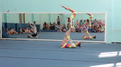 Female exhibition performance in sports acrobatics. Stock Footage