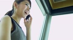 Female Asian Chinese Business Advisor Smart Phone - stock footage