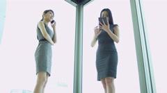 Female Ethnic Advertising Executives Smart Phone Mini Tablet Stock Footage